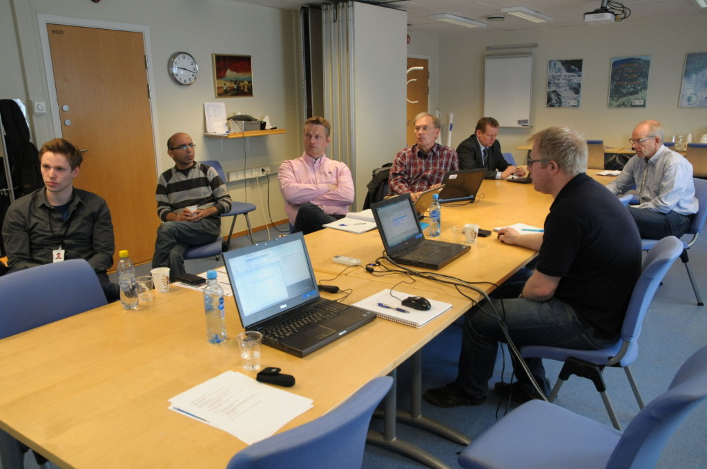 Dr Morten Hammer (SINTEF ER, centre-right) showed the seminar participants how to change interaction parameters in a commercially available thermodynamic software package.