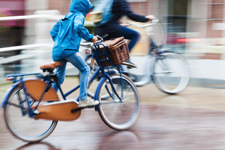 Riding bikes in the rain. Photo: Shutterstock