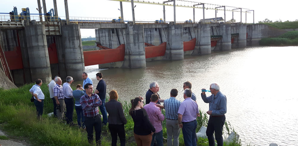 On-site discussions at a dam