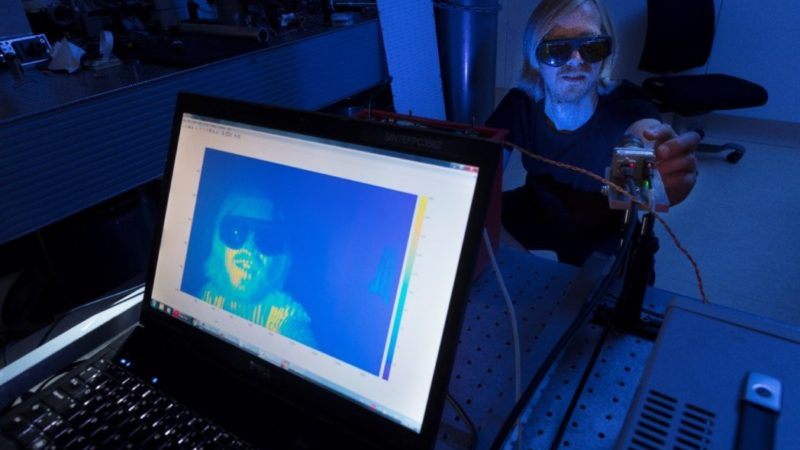SINTEF Digital's Jostein Thorstensen is adjusting the optics used for robot vision.