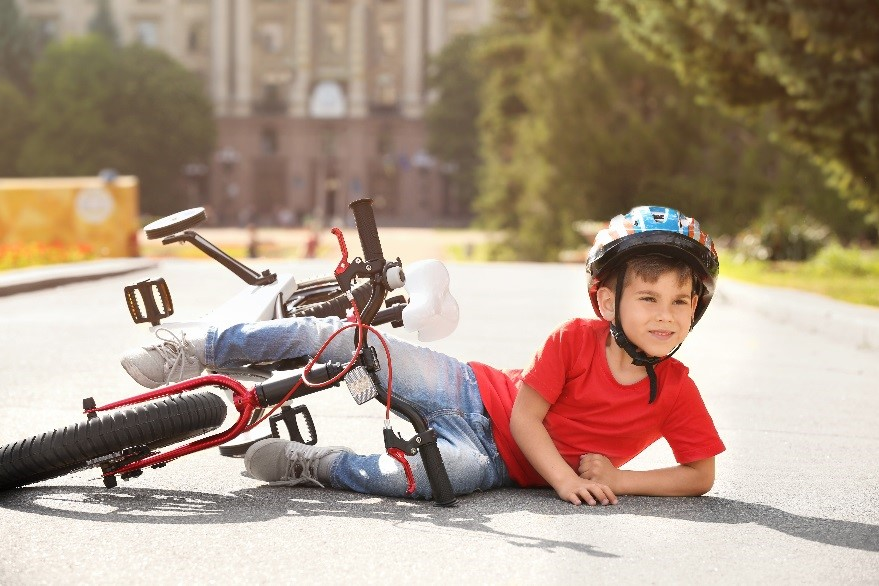 Child and bike having found a new equilibrium state. Photo: Shutterstock.