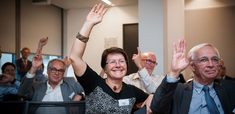 Audience hands up during the final discussion on the future for CO2 capture from cement.