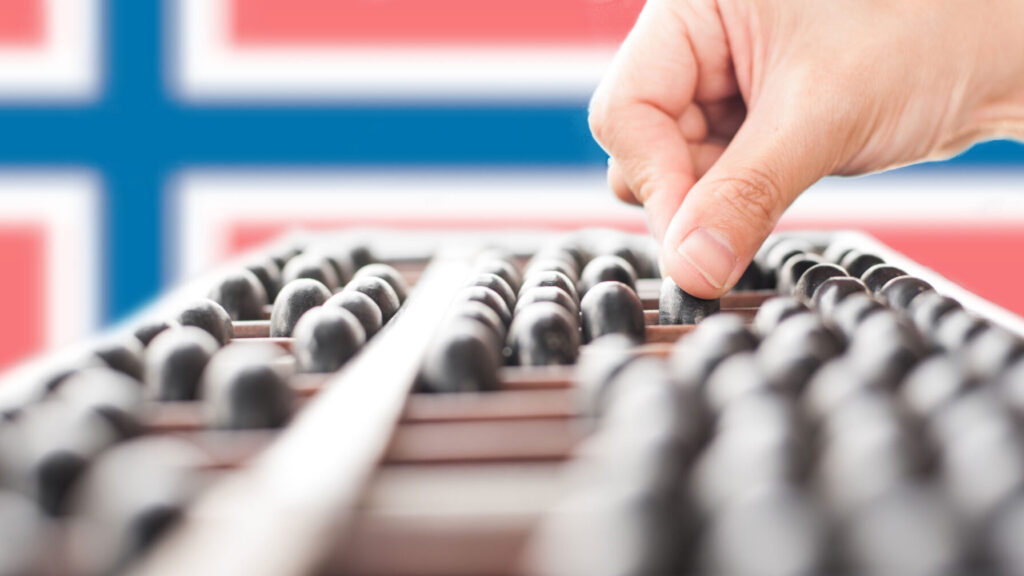 Hand using an abacus with Norway flag in background